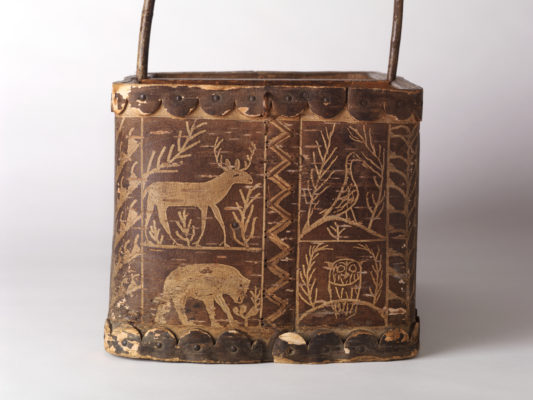 Side view of a birchbark picnic basket with a pictorial scene. Details of animals.