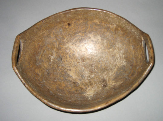 Top view of wooden bowl with two handles