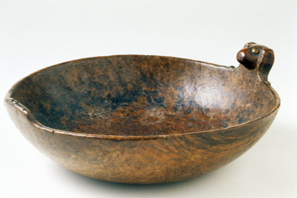 Side view of carved wooden bowl