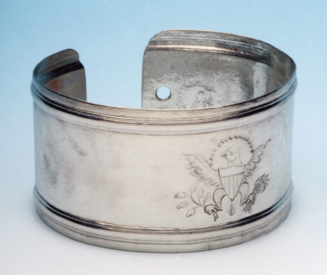 silver armband with the engraved seal of the United States