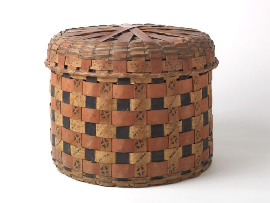 Side view of painted basket with lid