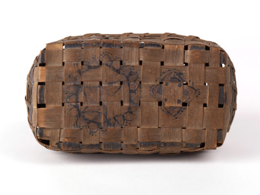 Base of basket with charcoal decoration