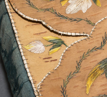 Detail of embroidery on the top of the case