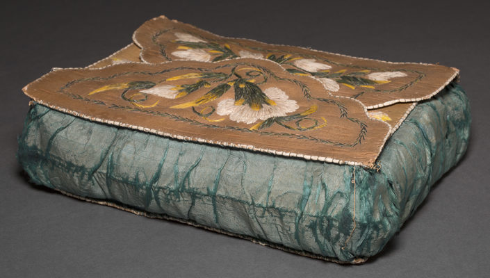 Detail of case showing top with embroidery and teal silk sides
