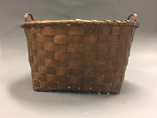 Side view of large basket with handles